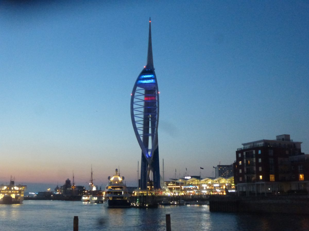 Photo of the Spinnaker Tower in Portsmouth Harbour lit blue for NHS70